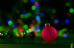 christmas balls on bokeh background color - stock photo
