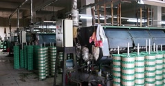 4k Machine Producing Tissues In A Silk Factory,Spinning Machine Collect silk. Stock Footage