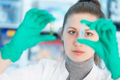 young student woman medical / scientific researcher / doctor looking at a test - stock photo