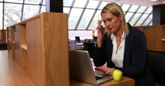 Librarian working in the library Stock Footage