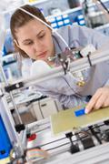 girl student makes the item on the 3d printer - stock photo
