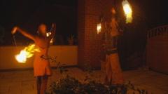 A couple fire dance 1 Stock Footage