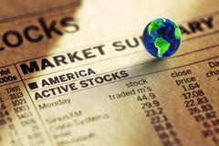 stock of the usa  market in the newspaper and globe - stock photo