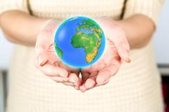 earth globe in female hands - stock photo