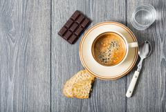 espresso coffee, biscuits and chocolate - stock photo