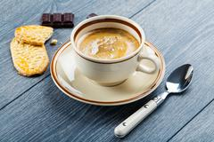 Cup of cappuccino coffee and cookies Stock Photos