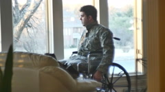veteran looking out window wheelchair - stock footage