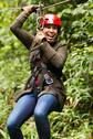 Stock Photo of Adult Slim Afro Woman Close Up Portrait On Zip Line In Ecuadorian Rainforest