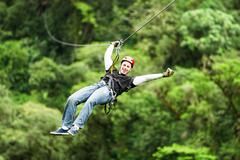 Adult Male Tourist Wearing Casual Clothing On Zip Line Or Canopy Experience In - stock photo