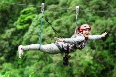 Adult Tourist Wearing Casual Clothing On Zip Line Trip Selective Focus Against - stock photo