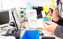repair and adjustment of the electronic device - stock photo