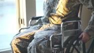 Stock Video Footage of veteran soldier moving wheelchair on sidewalk 3