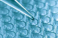 Pipette  load samples Stock Photos