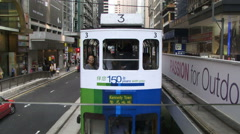 Tram moving into frame in Hong Kong city Stock Footage