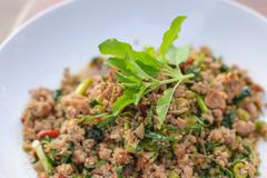 thai style spicy stirred fried green bean with pork and basil - stock photo