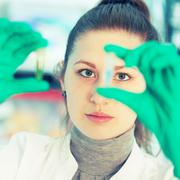 young student woman medical / scientific researcher / doctor looking at a tes - stock photo
