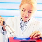 womanl with multi pipette in the laboratory of microbiology - stock photo