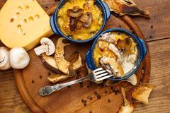 Moshroom casserole in a blue ceramic pot Stock Photos