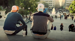 Two young people teens enjoying view at the Syntagma square Athens Greece. Stock Footage