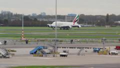 Airbus A380 Mega jumbo from Emirates landing in the distance Stock Footage