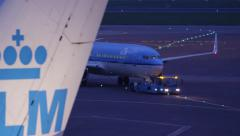 Airplane arriving at the gate in the very early morning Stock Footage