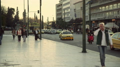 Athens Greece traffic people sunset near central Syntagma square Stock Footage