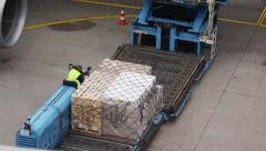 Cargo loading of large airplane Stock Footage