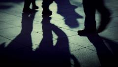 People walking crowd footsteps long shadows silhouettes 1 cold fx Stock Footage