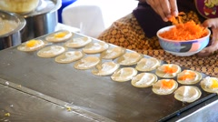 Kind of Thai sweetmeat Khanom Buang (a kind of filled pancake) Stock Footage