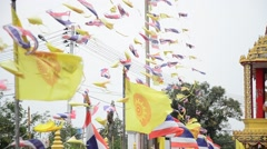Prayer flags and Flag of Thailand and Royal Flags of Thailand at Temple Stock Footage