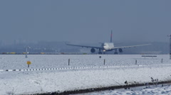 Airbus A330 airplane on take off, during a beautiful snow winter day - stock footage
