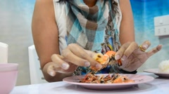 Women peeling shrimp or prawn grilled Stock Footage