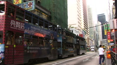 Trams and bus in main road Hong Kong Stock Footage