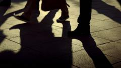 People walking crowd footsteps long shadows silhouettes 1 warm no fx Stock Footage