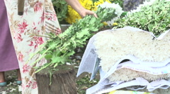 Mandalay, Flowers cut with machete Stock Footage
