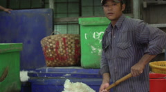 Mandalay, fish market, boy throws ice in fish tanks Stock Footage