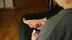 Woman Massaging Her Foot With A Numbing Cream, Over The Shoulder Shot, Rheumatis - stock footage