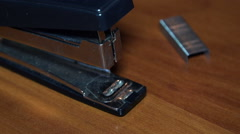 Close-up View of Hands insert Staples in the Stapler. Full - stock footage