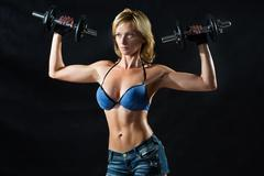 Low key silhouette of a fitness young woman. boobs Stock Photos