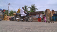 Street traffic and cow at Rameswaram in Tamil Nadu, India Stock Footage