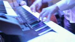 Musician playing keyboard at the party. Close-up. Chaotic camera Stock Footage