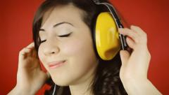 Music woman red headphones hands shy Stock Footage