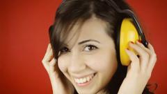 Music woman red headphones look sensual Stock Footage