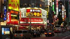 Busy Shinjuku Entertainment / Shopping District at Night  - Tokyo Japan Stock Footage