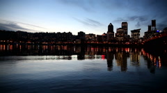 Panning Movie of City Colorful Night Lights in Portland OR with Water Reflection - stock footage