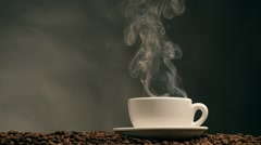 Cup of coffee on dark background Stock Footage