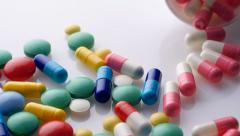 Close up of pills. White background. Sliding camera Stock Footage