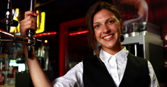 Smiling barkeeper holding beer pump Stock Footage