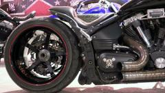 Black sport bike with wide wheels and skull. Traffic Cameras Stock Footage