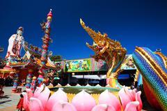 thai dragon or naga and guanyin statue - stock photo